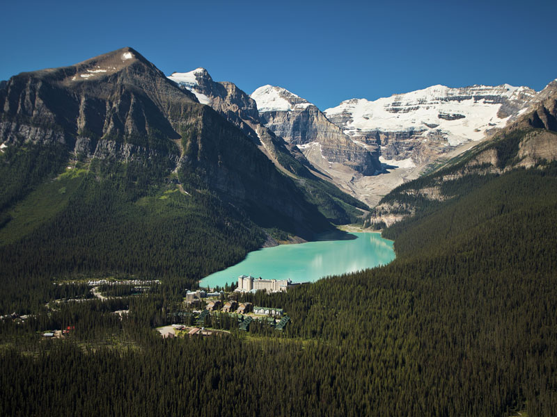 Majestic Canada Train Vacation through the Rockies | Fairmont Chateau Lake Louise with Victoria Glacier